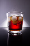 Cola with splash of ice cubes Royalty Free Stock Photo