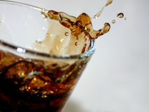 Cola splash II stock photos