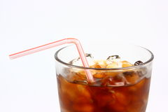 Cola With Staw. A close up photo of a glass of iced cola with a bent straw Royalty Free Stock Photo