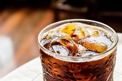 Cola in summer. A glass or cold cola in the summer time stock photos