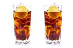Cola in tall glasses with ice cubes and lime Royalty Free Stock Photography