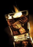 Cola with whiskey in glass and fire on black Royalty Free Stock Photography