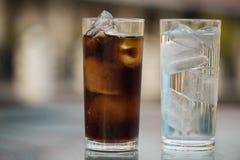 Cola y agua potable Foto de archivo
