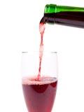 Colada de un vidrio de vino Imagenes de archivo