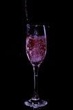 Colada del vino rojo Imagenes de archivo