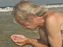 Colada en el mar fotos de archivo