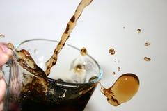 colafärgstänk Arkivbild
