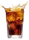 colafärgstänk arkivfoto