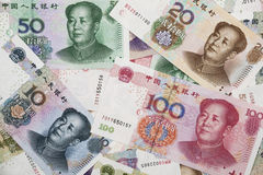 A collage of Chinese RMB bank notes. Background collage of Chinese Rmb bank notes  or Yuan with Chairman Mao on the front of each bill Royalty Free Stock Photo