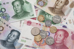 A collage of Chinese RMB bank notes and coins. Background collage of Chinese Rmb bank notes  or Yuan and coins with Chairman Mao on the front of each bill Royalty Free Stock Photo