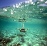 Colagem com a mulher que mergulha ao Underwater Fotografia de Stock