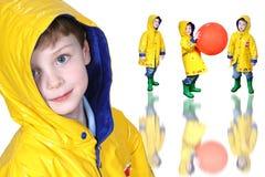 Colagem do menino no Raincoat e em carregadores amarelos de Froggie fotografia de stock royalty free