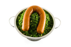 Colander with fresh kale and sausage Stock Image