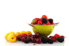 Colander with fruit diversity Stock Images