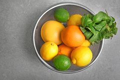 Colander with fruits. On grey background Royalty Free Stock Images