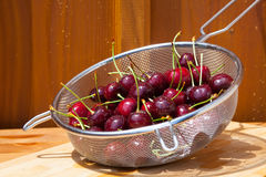 Colander full of cherries Royalty Free Stock Photo