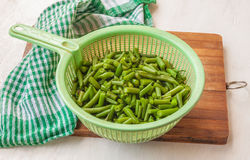 Colander with green bean Stock Photography