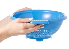 Colander in hand. On white background isolation Royalty Free Stock Photography