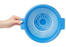 Colander in hand. On white background isolation Stock Photography