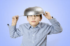 Colander hat. Young boy in colander hat Stock Images