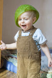 Colander on head of   baby Stock Image