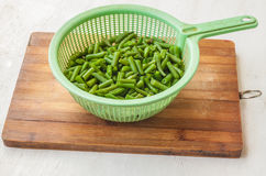 Colander with raw  green bean Stock Photography