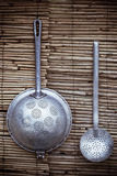 Colander and skimmer as a decoration Royalty Free Stock Image
