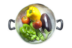 Colander with vegetables Stock Images