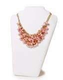 Colar cor-de-rosa bonita em um manequim Fotografia de Stock Royalty Free
