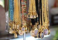 Colar do ouro com colar de buddha Imagem de Stock Royalty Free