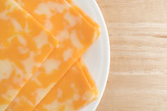 Colby-Jack cheese slices on a plate atop table top close Stock Image