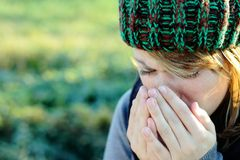 Cold. Woman with hat has to sneeze Stock Image