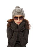 So Cold. Beautiful Girl in Knitted Hat, Warm Sweater and Sunglasses Shiver with Cold  closeup on white background Royalty Free Stock Photo