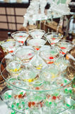 Cold alcoholic margareta cocktail. Glass with drink stands on the glass stand Stock Images