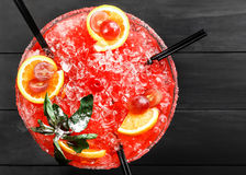 Cold alcoholic watermelon cocktail with orange, mint, ice and gr Stock Image