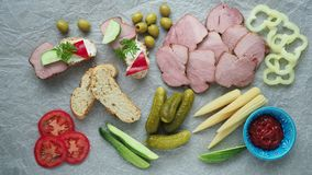 Cold appetizer. Cold cuts. Different snacks on a white crumpled paper, from above. 4k resolution stock video