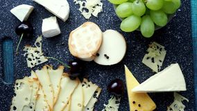 Cold appetizer. Cold cuts. Cheese on cutting board, top view. 4k resolution stock video