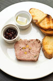 Cold appetizer with duck terrine and cherry sauce Stock Photo