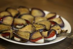 Cold appetizer of fried eggplant, cheese and tomatoes stock photo