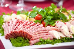 Cold appetizer with ham, cheese and fresh salad Stock Photo