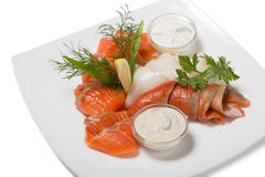 Cold appetizer of smoked halibut, salted trout, sockeye salmon s Stock Photography