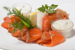 Cold appetizer of smoked halibut, salted trout, sockeye salmon s Royalty Free Stock Image