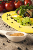 Cold appetizers of eggplant on a kitchen board with herbs, tomatoes, pepper and spice Stock Photo