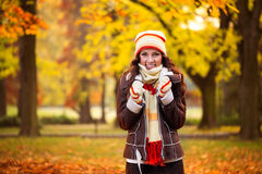 Cold autumn. Beautiful woman freezing in autumn park, cold autumn stock photography