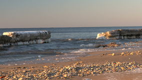 Cold Baltic sea in winter with icy beach stock footage
