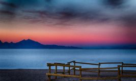 Cold Beach With the Fence. Sunset on the Bonneville Salt Flats in Utah with a wooden fence on the beach Royalty Free Stock Photos