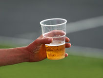 Cold beer. Man holding an ice cold beer at a sporting event Stock Photos