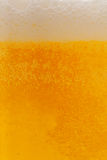 Cold beer. Close up of drink with bubbles and froth Stock Photo
