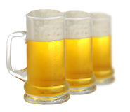 Cold beer. Three pints of beer isolated on white background Stock Photography