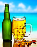 Cold beer on the beach Royalty Free Stock Images